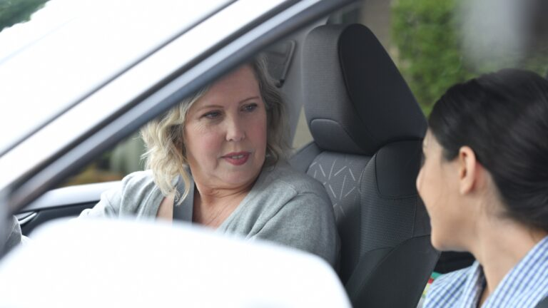 Mother and daughter talk in car