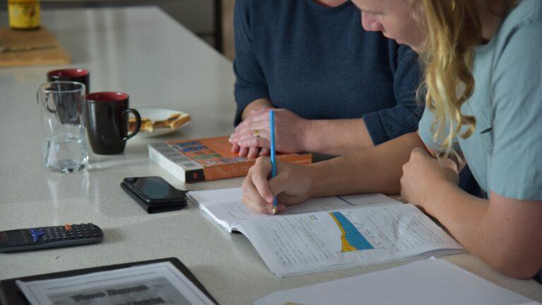 Mother helps son complete homework